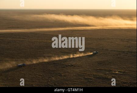 Russian Search and Rescue teams arrive at the Soyuz TMA-20M spacecraft shortly after landing with International - Stock Photo