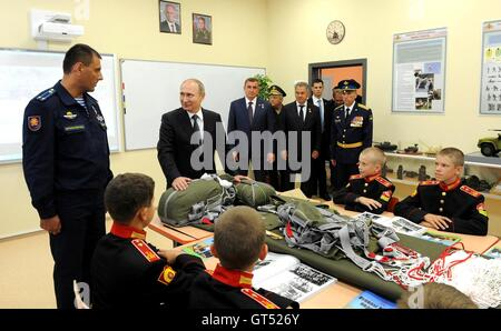 Russian President Vladimir Putin visits a class on parachute packing during a visit to the Tula Cadet School with - Stock Photo