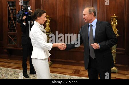 Russian President Vladimir Putin greets Anna Kuznetsova, the newly appointed Presidential Commissioner for Childrens - Stock Photo