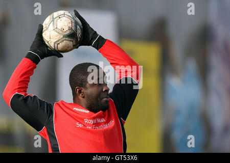 A Black Meteors player prepares to take a throw-in - Black Meteors (red) vs Wounded Knee - Hackney & Leyton League - Stock Photo