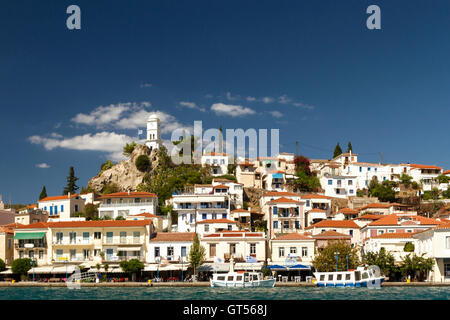 View of Poros town, Poros island, as seen from the coast of Galatas, in Peloponnese region, in Greece. - Stock Photo