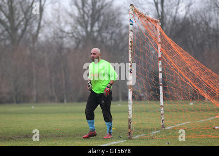 Clapton Rangers (blue) vs FC Bartlett - Hackney & Leyton Sunday League Football at South Marsh, Hackney Marshes, - Stock Photo