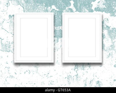 Close-up of two blank picture frames on aqua and white scratched concrete wall background - Stock Photo
