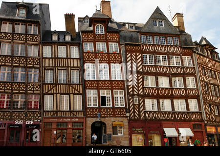 Typical half timbered gabled buildings in the old part of Rennes, Brittany, France. Crooked, leaning, slippage with - Stock Photo