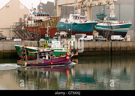 small fishing boat trawler coming in with catch, Sables d'Olonne France Stock Photo