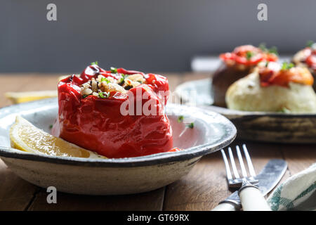 Baked red pepper stuffed with rice, peanuts and prunes. Traditional Greek Gemista. Rystic style - Stock Photo