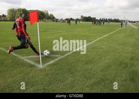 A Lapton player takes a corner during a match against Army & Navy - Hackney & Leyton Sunday League Football at South - Stock Photo