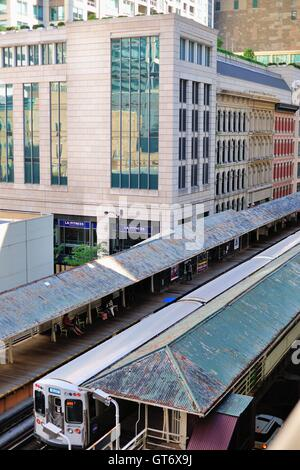 CTA Green Line train pauses at the Randolph/Wabash elevated stations above Wabash Avenue on its journey through - Stock Photo