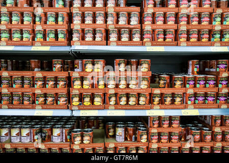 Various types of Heinz soups on display in a supermarket. - Stock Photo