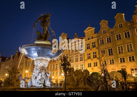 Neptune's Fountain, the landmark 17th-century bronze statue of the sea god surrounded by historic houses of Gdansk's - Stock Photo