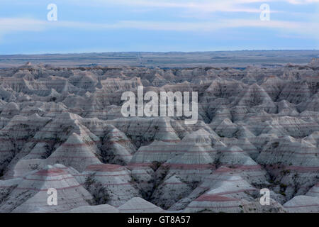 Landscape view of the Badlands National Park in South Dakota showing the topography of the eroded rock forming buttes - Stock Photo