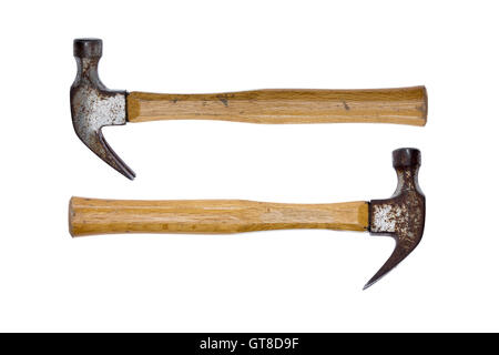 Two old rusty claw hammers arranged facing in opposite directions conceptual of equal power isolated on a white background