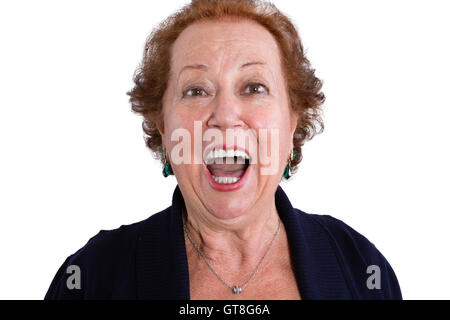 Close up Shocked Face of a Senior Woman Looking at the Camera with Mouth Wide Open, Isolated on White Background. - Stock Photo