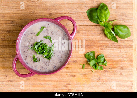 Delicious Homemade Cream Of Mushroom Soup With Minced Fresh Mushrooms Garnished With Chopped Basil Overhead