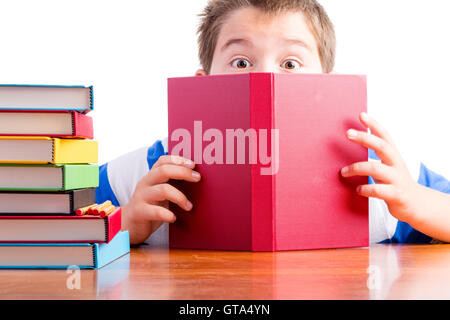 Conceptual image depicting curiosity making learning easy for schoolchildren with a young elementary school boy - Stock Photo