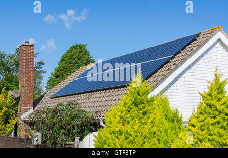 Solar panels on the roof of a bungalow in the UK. - Stock Photo
