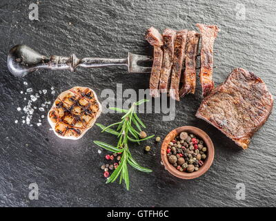 Steak Ribeye with spices on the graphite tray. - Stock Photo