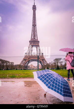 Rainy day in Paris at Eiffel tower - Stock Photo