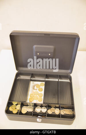 An open cash box with money inside. - Stock Photo