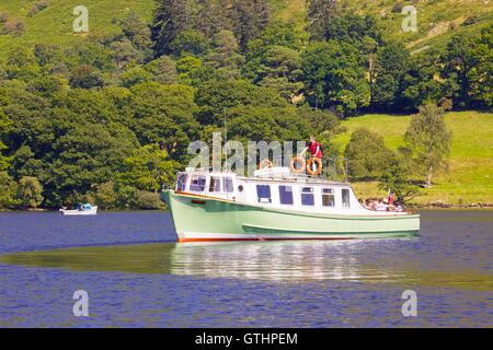 Tourists enjoying a cruise aboard an Ullswater Steamer. Ullswater, Penrith, The Lake District National Park, Cumbria, - Stock Photo