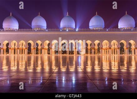 Sheikh Zayed Grand Mosque in Abudhabi sending beautiful light rays - Stock Photo