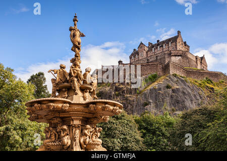 The Ross Fountain in Princes Street Gardens, and Edinburgh Castle, Scotland, UK. - Stock Photo
