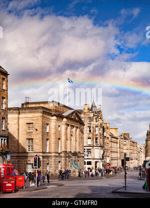 The Royal Mile, Edinburgh, with a rainbow, Scotland, UK - Stock Photo