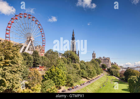 View of East Princes Street Gardens, Edinburgh, in late summer, with the Festival Wheel, Scott Monument and Balmoral - Stock Photo