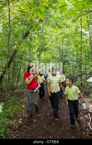 Detroit, Michigan - Fifth grade students from Dixon Elementary school, hike on the Stone Bridge Nature Trail in - Stock Photo