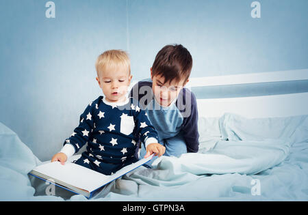 children jumping on the bed - Stock Photo
