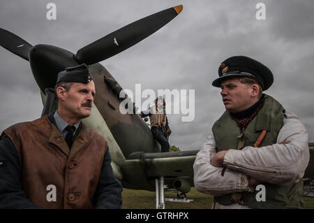 Spitfire crew and pilot re-enactors. Second World War, Battle of Britain fighter plane scenario. Bad weather. Space - Stock Photo