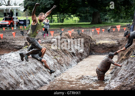 Cheshire, UK 10th September 2016. Participant leaps into the water at Tough Mudder North West 2016 10/09/2016  Credit: - Stock Photo