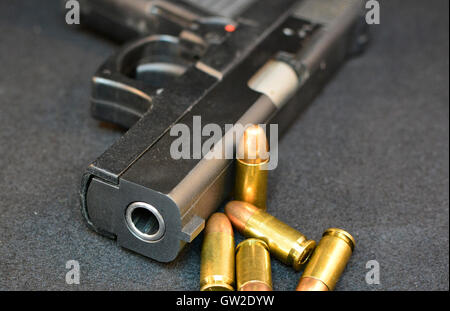 Handgun with bullets. Gun violent crime, assault. Shooting. Gun use. - Stock Photo