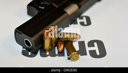 Crime concept. Handgun with bullets gun violent crime, assault. Shooting. - Stock Photo