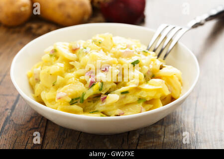 fresh potato salad with red onion and chives - Stock Photo