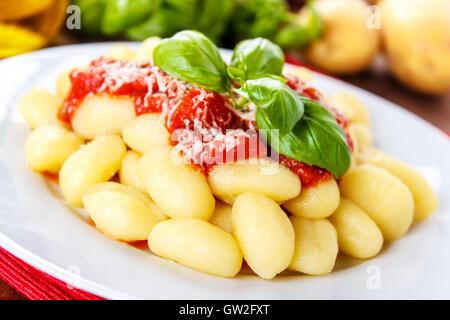 fresh italian gnocchi with tomato sauce and parmesan cheese - Stock Photo