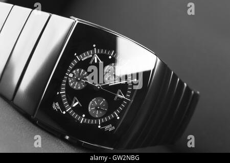 Mens chronograph watch made of high-tech ceramics with sapphire glass over black. Selective focus - Stock Photo