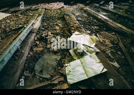 The Consequences Of The Nuclear Pollution After Chernobyl Disaster. The Pupil's Copybook On The Ruined Floor Of - Stock Photo