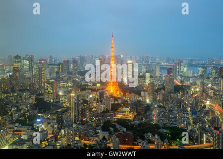 Tokyo tower and Tokyo city skyline and skyscraper in night at Tokyo, Japan - Stock Photo