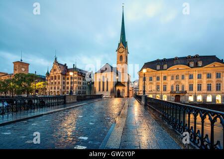 Fraumunster Church and Limmat river in Zurich, Switzerland  . Image of Zurich, capital of Switzerland, during night. - Stock Photo