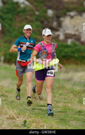 Runners finishing Anglesey Ultra Marathon, Ring o Fire - Stock Photo