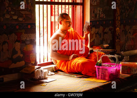 CHIANG MAI, Thailand - August 7 , 2016: Two Young Buddhist novice monk in monastery and people Make a metit in CHIANG - Stock Photo