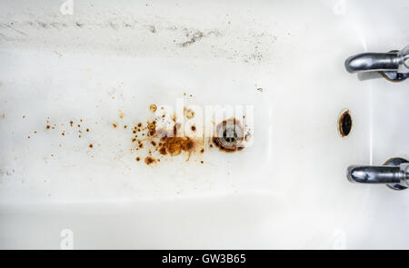 An old, rusty abandoned enamel bath tub. - Stock Photo