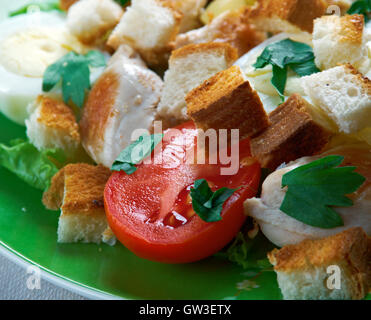 ensalada cezar con pollo- Mexico salad of romaine lettuce and croutons dressed with parmesan cheese, chicken, olive - Stock Photo