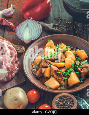 Pork and potato stew rustic style - Stock Photo