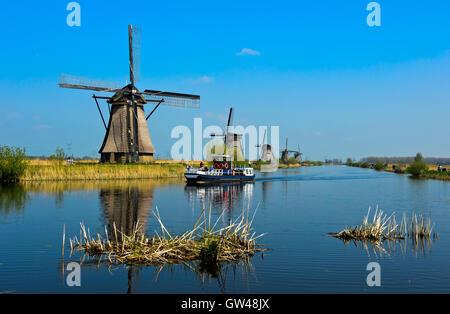 Dutch Windmill at a canal, Kinderdijk, Alblasserwaard polder, South Holland, Netherlands - Stock Photo