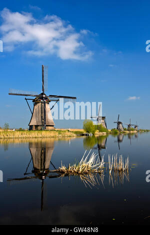 Dutch Windmills at a canal, Kinderdijk, Alblasserwaard polder, South Holland, Netherlands - Stock Photo