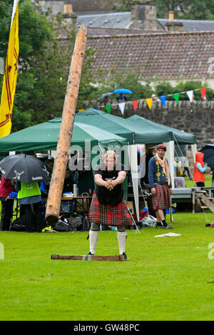 Participant in the caber tossing competition, Ceres Highland Games, Ceres, Scotland, United Kingdom - Stock Photo