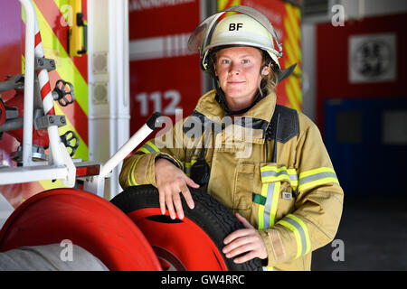 Mannheim, Germany. 24th Aug, 2016. Firewoman Lisa-Katharina Roeck stands next to a fire engine at the southern fire - Stock Photo