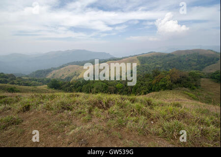 Looking over the mountains and jungle of the Periyar Tiger Reserve in the foothills of the Western Ghats near Thekkady - Stock Photo